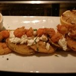 fried green tomatoes with goat cheese and fried crawfish from the lobby bar.