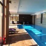 Indoor pool wi patio doors to large terrace wi loungers