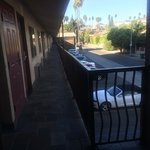 View from front door of 2nd floor corner room. Stairs located just to the left in photo. View of