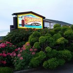 Outdoor sign upon arrival, The Cedarwood Inn and Suites  |  9522 Lochside Drive, Sidney, British