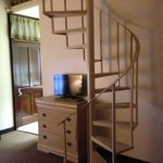spiral staircase to loft and bed