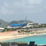 Plane taking off by the beach