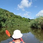 Heading up Hanalei River in a double kayak