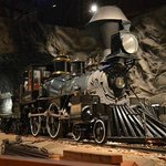 A locomotive traveling through a tunnel at the California State Railroad Museum