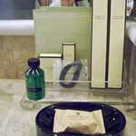 Bathroom supplie: toothbrushes, hair tie, lotion, soap, etc
