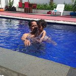 Swimming pool with sweety daughter
