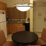Kitchen and dining- small, brown, and mismatched.