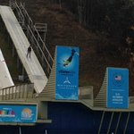 Free Style Ski Jumper coming down the hill
