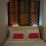 Bed with decorative patterns and cove lighting