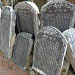 stone tablets waiting to be placed back in place after renovation