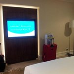 Large wide flat screen TV mounted on the wall