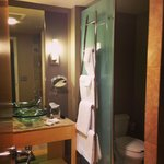 Executive Room bathroom with partial enclosed bathroom and separate shower with glass door