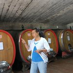 Maria explaining the initial aging in large barrels