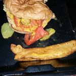 I try not to post half-eaten food. However, this veggie burger was scrumptious, so I could not r