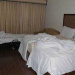 This was after the room was left, NOT how we found it. There is an extra bed they provided as we