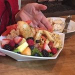 chicken salad with sides of pasta & fruit salad