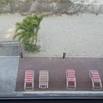 View of beach chairs on the sand