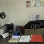 the front desk (with Nur at the counter)