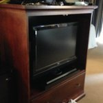 A small flat screen....but in an old tv cabinet