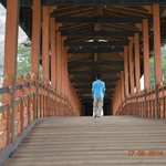 The bridge that leads to the Dzong (Yes, that's me walking)
