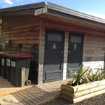 Recycling/refuse area plus toilets/showers for campers. Main office is attached on the right.