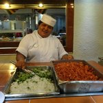 One of the friendly staff, but it didn't make the food any more palatable.S