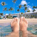 Happy Feet in the beautiful ocean adjacent to the hotel