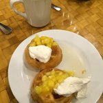 Waffles with coconut syrup, pineapple bits and whipped cream