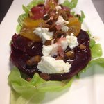 Beet salad, goat cheese, toasted pistachio, roasted beet vinaigrette.
