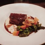 Slow braised short ribs, polenta, broccoli rabe, carrot, cippolini onion.