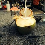 Pina colada cocktail in a coconut at the poolbar
