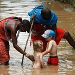 children in the river with Masai warriors