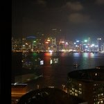view of the harbor and hk island from suite 80 at night