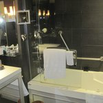 Bathroom with lit make-up mirror and shower