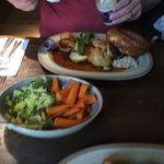 Three meats Sunday lunch with seasonal vegetables