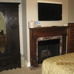 fireplace, TV and cabinet