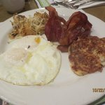 easy over eggs, bacon and potatoes