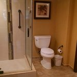 Renovated bathroom 1-BR Deluxe 422A - separate toilet & shower from whirlpool tub and large vani