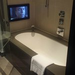 The bath with the TV at the end