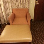 Room was dark and dingy, with old worn out furniture. Not very cozy or comfortable.