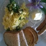 Egg scramble with ricotta and spinach, fresh local sourdough bread and yummy sausages