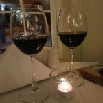 A glass of red wine in the beautiful restaurant.