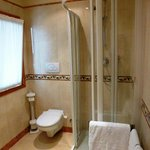 Bathroom with enclosed shower