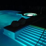 Outdoor pool and jacuzzi at night