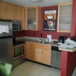 Kitchen with full size fridge (Ice maker), stove with oven, microwave and coffee pot.