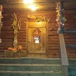 The front of the cabin with fall decor
