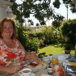 Karen having breakfast on the terrace.