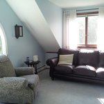 the sitting area of the upstairs cottage room