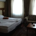 Bedroom suite with two twin beds together as a king
