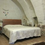 Beautiful stone arch room with a double bed and a single bed (unpictured).